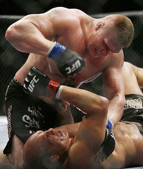 Lesnar pounds on a prone Couture after a blow behind left ear felled the aging champion.