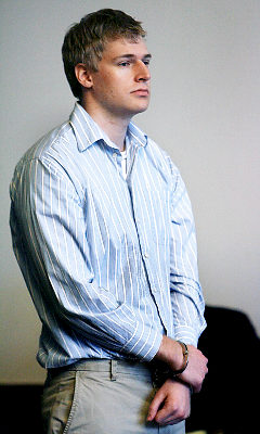 Is this the posture & mask of a killer? Philip Markoff in Boston Municipal Court, on April 21, 2009. Shades of Jeffrey Dahmer? Time will tell ....