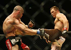 Franklin connects with Silva in a three round thriller of UFC 99 in Germany. (Hermann J. Knippertz / Associated Press)