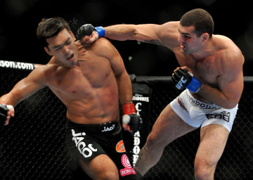 "The Deconstruction of Lyoto Machina at UFC 104 by a fearless young gun: Mauricio ""Shogun"" Rua clobbers Machida in one of the barrages that drew blood and a cut lip towards the end. (Photo: Jon Kopaloff/Getty Images)"